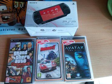PSP με παιχνίδια ελάχιστα χρησιμοποιημένο στο κουτί του δεν έχει