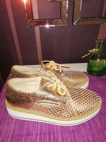 Ženska obuća   Beograd: Cipele sa zlatnim šljokicama