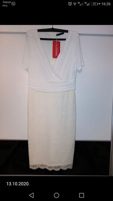 Potpuno nova haljina,sa etiketom vel 42, sa puno elastina. Donji deo