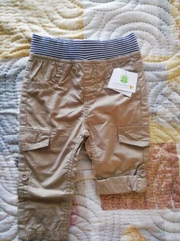 Nove pantalone za decaka, vel 74. Mogu kao kratke ili duge, materijal