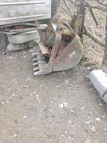 Qax şəhərində Traktor çömçəsi