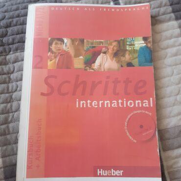 Schritte international Kursbuch+Arbeitsbuch A1.2Состояние 9/10Ничего