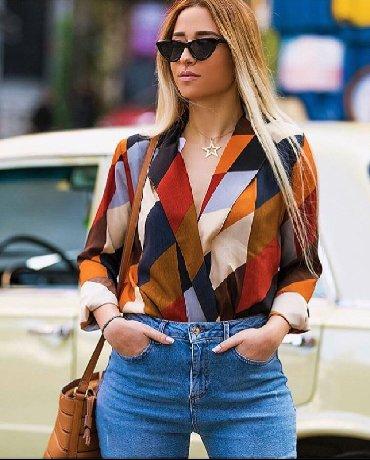 qoroşkalı qadın bluzu - Azərbaycan: Yenidir. Body bluz zara modeldir, 15azn