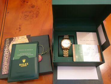 - Azərbaycan: Qızılı Qadın Qol saatları Rolex