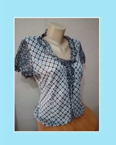 Ordo bluza za tell icine oko - Srbija: Bluza sa prelepim puf rukavicima,ima karner oko okovratnikaPrijatna je