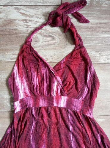 Duga letnja leprsava haljina. Vezuje se oko vratasa elastinom