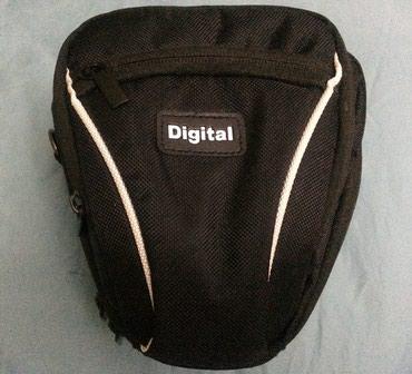 чехол для фотоаппарата canon 600d в Кыргызстан: Чехол сумка для цифрового фотоаппарата.Имеется плечевой ремень и есть