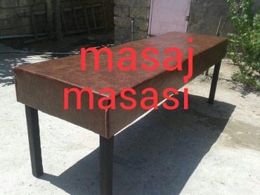 Bakı şəhərində Masaj stolu teze mohkem yumusaq her rengde kojalardan baw terefi