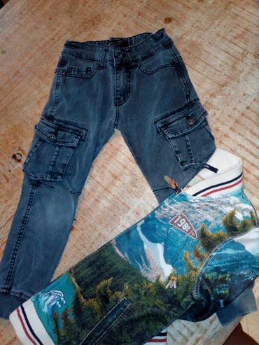 Ελαστικο γκρι παντελονι για παιδακι 4μιση -5μιση με πλαινες τσεπες