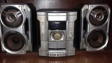 Bakı şəhərində 150 манат В рабочем состоянии.Три диска,караоке ,радио.