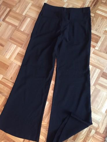 Pantalone sa - Srbija: Pantalone sa sirim nogavicama.Udobne,sa elastinom