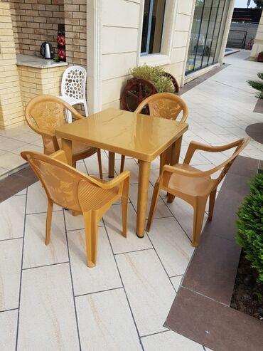 Plastic masa ve oturacaqlar satilirher bir malimiz