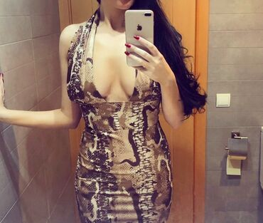 Letnja haljinica snake print nosena samo jednom  Haljinica sadrzi likr
