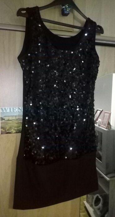 Crna elegantna haljinica, jednom obucena. Placena 2500, prodajem za