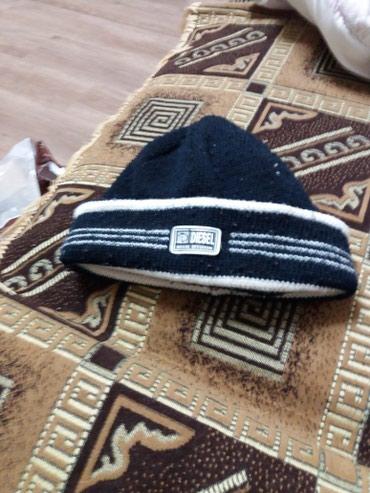 Продаю шапку теплая зимняя