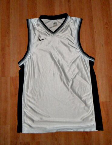 Kosarka - Srbija: Kosarkaski dres marke Nike Kosarkaski dres,bele boje,marka