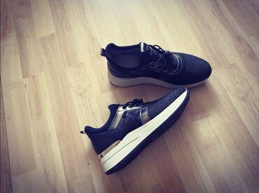 Kozne cipele - Srbija: Na prodaju Prelepe Nero Giardini Kozne Zenske Patike, crne, sa sivim d