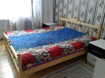 Кровать из дерева в Bakı