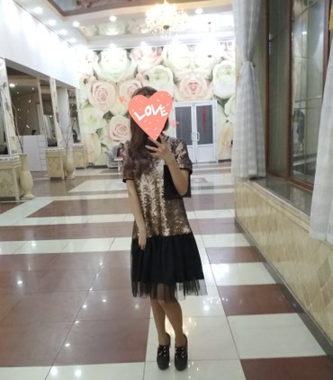 Продаю платье. В золотистых пайетках, свободное. Одевала один раз. в Бишкек