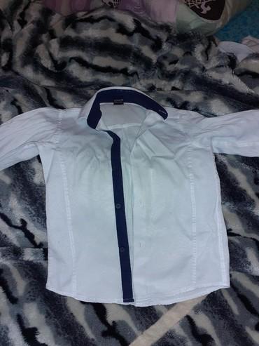 Школьная рубашка на 7.8лет два рубашка 7манат