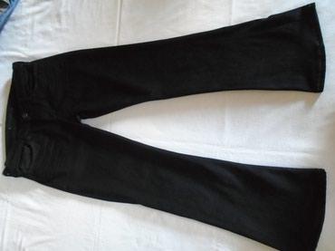 Crne farmerke/pantalone sa zvonastim nogavicama, proizvedene u - Belgrade