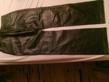 Bez pantalone broj - Srbija: Kozne pantalone broj 42 nove bez ostecenja. Struk 40 cm, kukovi 54 cm