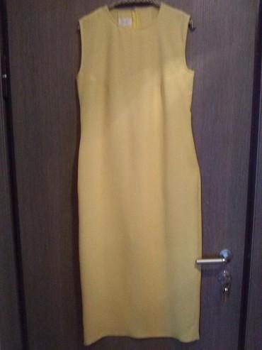 Haljina dugačka žuta od punijeg letnjeg žoržeta. Kroj prati liniju - Crvenka