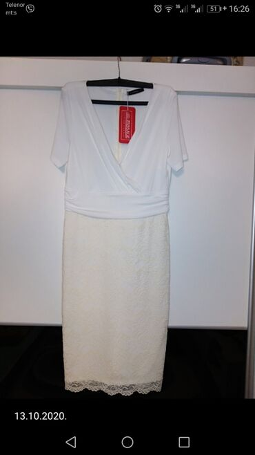 Potpuno nova haljina, sa etiketom, vel 42, sa puno elastina, donji deo