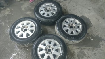 продаю диски r14 с резиной разболтовка 5/114 не кривые отболонсированн в Бишкек
