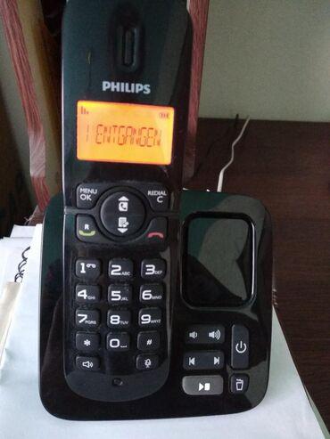 Безпроводной телефон почти новый на фото видно