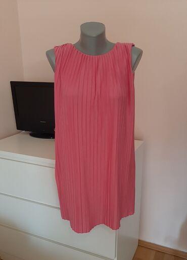 12 oglasa: Zara girls haljinaPlisirana, boja pinkSiri model koji padaOdgovara S/M