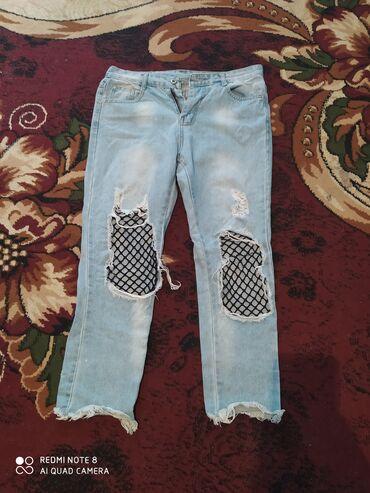 Рваные джинсы в хорошем состоянии размер l