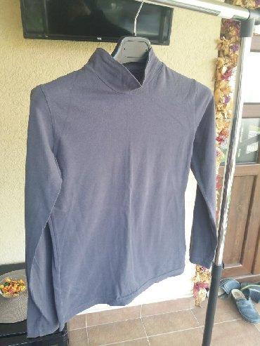 Pamucna rolka sive boje i univerzalne velicine. Nosena ali je ocuvana