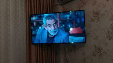 Televizor 700 azn 100 ekran alinib 1300 azn Bineqedi seherciyi lale 2