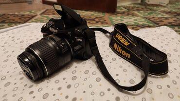 Электроника - Таш-Мойнок: Продаю зеркальный фотоаппарат Nikon D3100. Чехол-сумка, стоковый