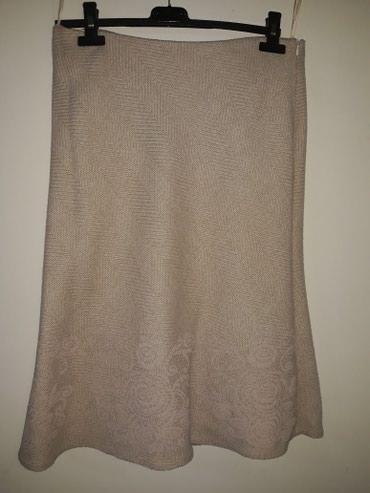 Deblja zimska suknja,trikotaza sa interesantnom sarom,obucena nekoliko - Smederevo