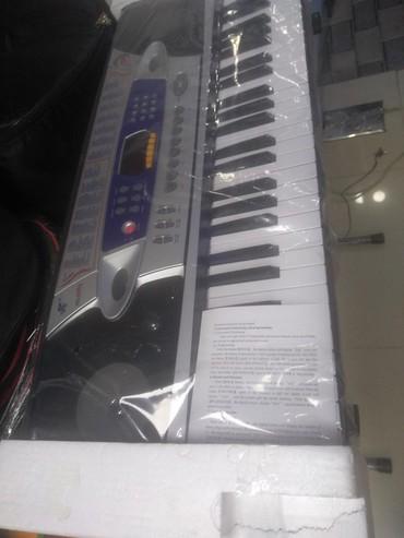 Sintizator 4 oktava yarım mikrafonlu böyük ölçülü Piano diller RK
