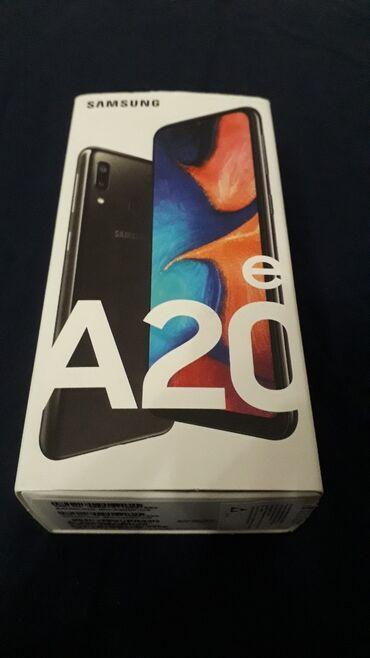 Mobilni telefoni i aksesoari - Srbija: SAMSUNG Galaxy A20e nov, ne raspakovan, slušalice, punjač