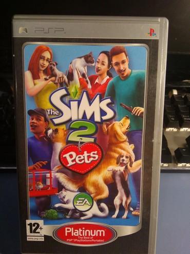 PSP (Sony PlayStation Portable) в Кыргызстан: Игра для PSP The, Sims 2 Pets (документация на русском языке). Б/У