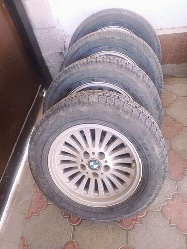 диски японские в Кыргызстан: Диски с зимними шинами паук, стояли на BMW e39 состояние протектора