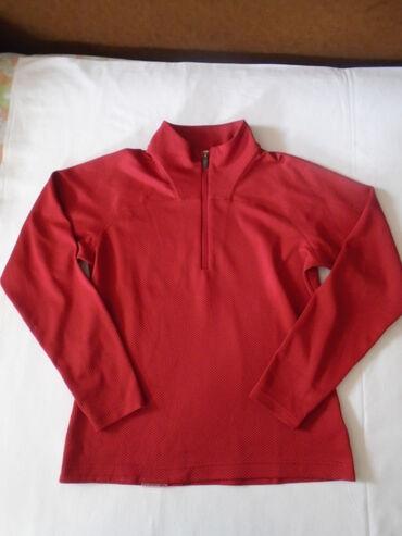 Salomon original, crveni sportski duks. Nije naznaćena veličina ali re