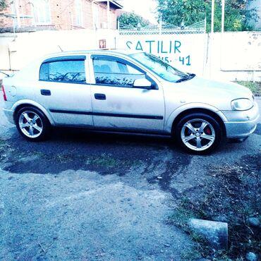 qarisqa yagi - Azərbaycan: Opel Astra 1.8 l. 1998 | 282284 km