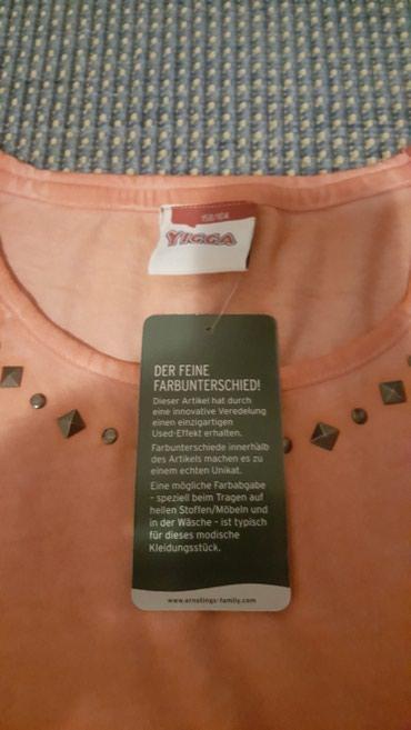 Ostalo | Sremska Mitrovica: Nova pamucna majca narandzaste boje. Novo