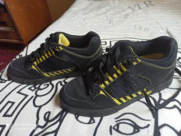 Кроссовки на колесах Heelys Original. Привезены из Германии. Состояние