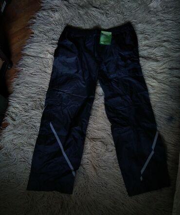 Nove muske pantalone za rad.Etikete su uslikane.Velicina pantalona je