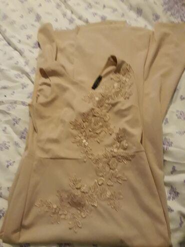 Duga haljina jednom obucena odgovara l 550 din