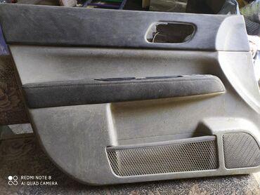 Обшивка передние двери форестер 2003