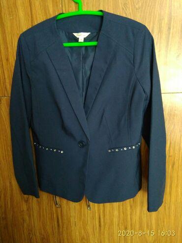 Продается женский пиджак. Б/у, цвет темно-синий, размер 40