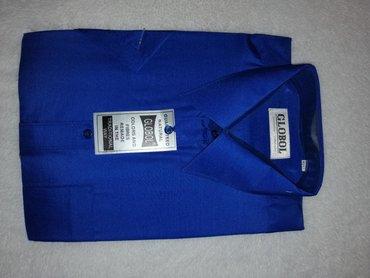Muška košulja kratkih rukava, tamnoplave boje.Košulja nikada nije