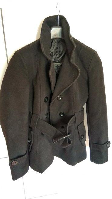 Ženska odeća | Lazarevac: Kaput_________Lep zenski kaput crne boje, malo koriscen. Stanje kao na